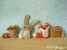 Felt Woodland Creatures - in the movie there is are foxes, dogs, an owl, a sparrow, a woodpecker, a badger, a caterpillar, and a mean bear. :)