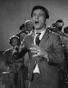 Norman Wisdom the British slapstick comedian who also works on stage and television in a scene from the film which was his debut in the film business...