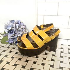 c5ccc1739b02 Amazing vintage platform shoes from the 1970s. These shoes have patent  leather yelllow upper and