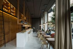Barton Restaurant Barcelona by Isabel Lopez Vilalta and Magul Gonzales is structured into 3 parallel spaces: long bench, exposed pantry and the bar.