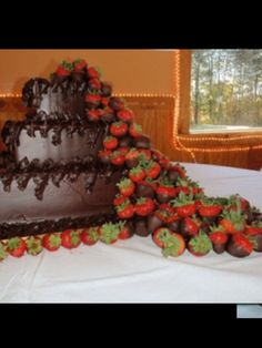 Chocolate cake with a mountain of chocolate strawberries.