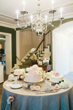 Simple wedding cake quartet adorned with fresh flowers | Sweet Little Photographs