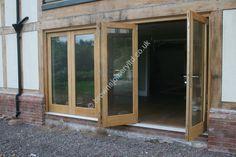 Garden Door Glazed Bifold sliding doors in solid oak and accoya www.brownsjoineryltd.co.uk