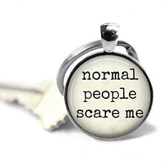 """Normal People Scare Me - Quote Key Chain - Funny Quote - Funny Key Chain - Sarcastic Quote. """"normal people scare me"""" - Handcrafted round pendant measures 1 inch across (25mm) and has been created using a shiny silver or antique bronze tone bezel. Artwork has been sealed under a non-yellowing, scratch resistant, high gloss epoxy bubble which enhances the image. The pendant comes with a matching key ring. The entire key chain measures 2.5"""" long. Water resistant, light weight, and durable."""