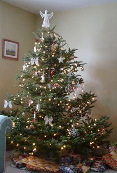 real christmas tree, crochet angel on top