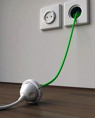 extension lead stored in the wall - Genius! You'd just have to have an automatic wind up function
