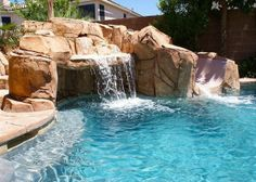 Pacific Pool Grotto Slide With Custom Stone Table For