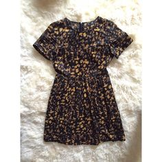 Madewell Dress: Seen on Anne Hathaway/Katie Holmes This Dress is SO Flattering!  For Sale: Black with Brown/Gold Hue Asymmetric Dot Pattern (it is not animal print). Pictured in photos 2-4. Ramie cotton material  Not for Sale: Chambray. Same style/cut as the black/brown/gold hue version for sale.   Cuff Sleeves, Hits Slightly Above Knee.   Worn twice and is in perfect/new condition. It has been dry cleaned. Madewell Dresses
