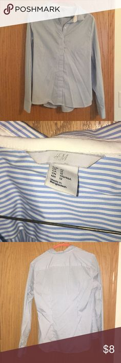H&M business shirt. Size 12 H&M business shirt light blue and white pinstripes. Size 12. Only worn a hand full of times. Looks new just a few wrinkles from being in my closet. Looks fitting on H&M Tops Button Down Shirts