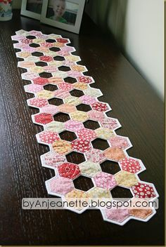 Great use of negative space in this hexie table runner   Anjeanette Klinder