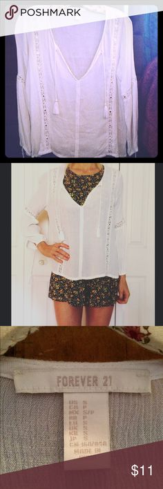 Forever 21 White Peasant Top Small You are looking at a forever 21 White peasant top. Size small. Never worn. Impeccable condition. Thanks for looking! Forever 21 Tops Blouses