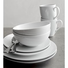 Shop Set of 8 Essential Dinner Plates. Crisp white oversized coupe shapes in durable porcelain go casual for everyday, or sophisticated for formal dinners.