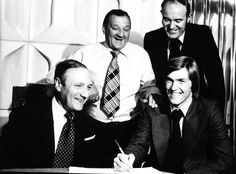 Kenny Dalglish signs for Liverpool for a British record fee of £440,000 watched by manager Bob Paisley, white shirt chairman John Smith left and club secretary Peter Robinson