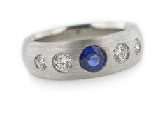 S19 Band in platinum with burnish set diamonds and a sapphire