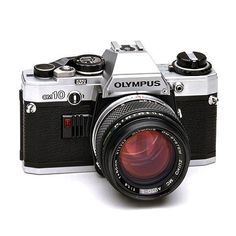 Olympus OM-10 - classic camera of the mid-20th Century photo-journalist - best camera ever for being part of a scene - no telephoto lens here - get amongst!