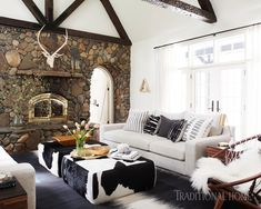 Inside a charming Tahoe cabin with a chic and modern twist! (Mix and Chic) Living Room Bench, Living Room Colors, Living Rooms, Family Rooms, Apartment Living, Living Spaces, Cowhide Bench, Modern Lake House, Modern Cabins