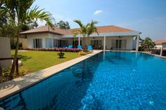 A very large swimming pool with overflow (infinity) with mountain views & tropical landscaped garden surrounding it.