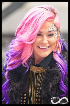 I really like this woman's voice and hair. She has pink and purple hair and is still beautiful!