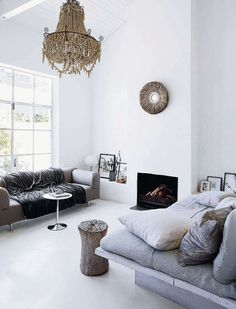 a splendid beaded chandelier and textured textiles in white and grey // cape town house