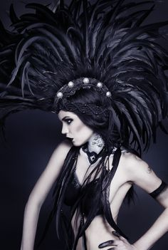 Model: Alexandra Mathews. Headpiece: Miss G Designs. Photographer: Sasha Sheldon.  [black feather mohawk]