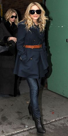 Ashley Olsen accented her skinny jeans and classic navy coat with a stylish brown leather belt and spiked-heel booties.