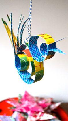 makkelijk vogeltje, gemaakt met reepjes papier. Kies voor blije kleurtjes om een vrolijk resultaat te krijgen!