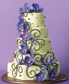 Fleur de Lisa Wedding Cakes and Specialty Desserts, Santa Rosa, CA    This design, by Lisa Marie Kincaid, started with a simple vine—and grew from there! Fondant cake with sugar-paste clematis, dark chocolate vine and sugar balls. 16 dollars per slice, serves 175; fleurdelisacakes.com.