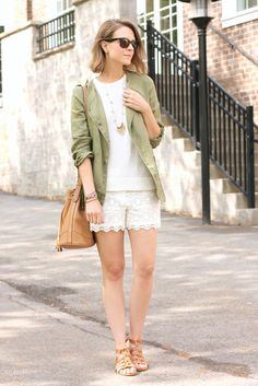 spring / summer - street style - street chic style - beach style - summer outfits - beach outfits - olive green jacket - military jacket - utility jacket + white knit top + white lace shorts + nude gladiator sandals + black sunglasses + brown shoulder bag + gold statement necklace