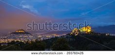 Athenian panorma by night under the cloudy sky, Greece