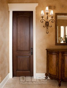 Not sure how I feel about the dark stained door with the white trim.  I have been considering this option for the foyer.