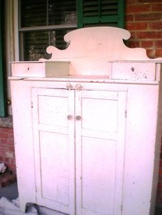 BEFORE OLD CABINET