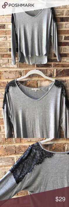 🌷Red Haute Tee GUC. Gray long sleeve tee with lace detail on shoulders. Tiny thread bump on front as shown otherwise is no other noticeable flaws. Hand wash and lay flat to dry. All photos taken in natural light. 💰Reasonable offers considered. Photos may not be used without permission. Red Haute Tops