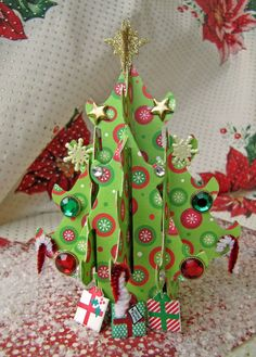 Card by Carolina Garrido  (120911)  designer's site http://caromgar.blogspot.com/2011/12/pop-up-trees.html  5 video tutorials by Karen Burniston  (120909) http://karenburniston.typepad.com/i_am_not_lefthanded/2009/12/video-tutorial-sizzix-popup-christmas-tree-die-sizzlit-decorations.html  [Sizzix  Bigz XL Tree, Christmas 3-D Pop-Up]