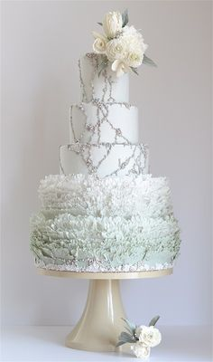 Sugared freshwater pearls and frills give this classic white wedding cake by #LoveList member Maggie Austin Cake a sophisticated touch.