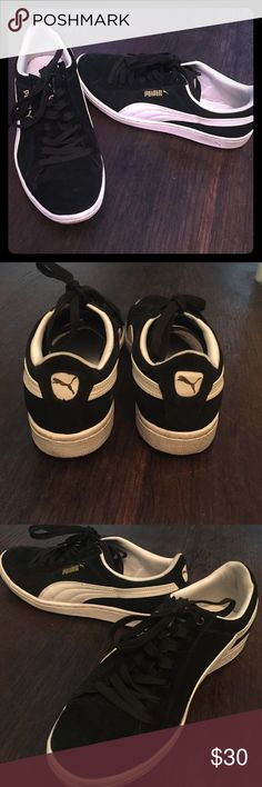 Puma sneakers Mint condition black and white Puma sneakers. Black suede and white leather with gold Puma logo. Puma Shoes Sneakers