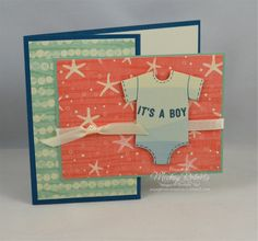 "Blog Post Date:  January 8, 2017.  A clever gift card holder is concealed behind the card front of this new baby card featuring the Any Occasion Sale-A-Bration stamp set.  Other elements of this card include:  By the Shore Designer Series Paper, Very Vanilla 1/4"" Satin ribbon, Baby's First Framelits for the Big Shot, and the cardstock colors of Dapper Denim, Mint Macaron, and Very Vanilla.  The slot for the gift card holder (not shown) uses the Classic Label punch."