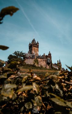Visit the Hogwarts Aesthetic Castles in Germany! Cochem has one go the most beautiful places / castles to visit in germany and it makes a great wallpaper / photography spot. Visit the fairy tales castles with this germany travel itinerary for the Mosel Valley and go crazy with your own photography.   #hogwarts #germanycastles #bestcastles #germanytraveltips #germanytips #germancastle #fairytalecastle #germanyaesthetic