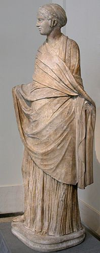 Young woman enveloped in a Greek himation (cloak), wearing a head-cap; Roman copy of a Hellenistic Greek work. 1/2nd century CE. NY: Metropolitan Museum of Art.
