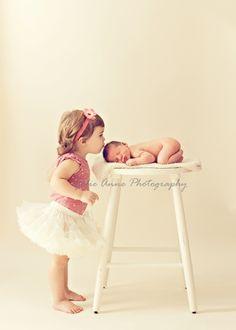 newborn big sister pose