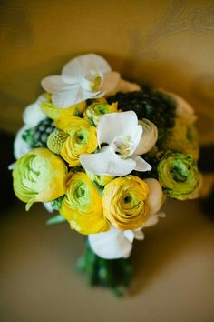 Pretty Bouquet Composed Of Yellow Ranunculus, Green/Yellow Ranunculus, Silver Brunia, & White Orchids>>>>