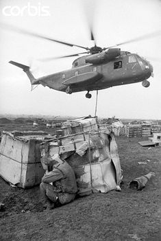 A few minutes rest for an exhausted Marine despite the noise and dust from the helicopter who is dropping suppies. Oct 1967, Con Thien, South Vietnam | by tommy japan