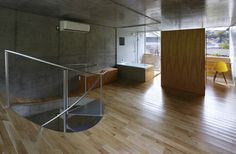 House in Byoubuguara Uses Curved Floors to Maximize a Small Fo...
