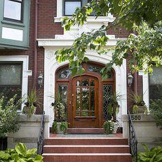 Ornate glasswork makes this front door an eye-catching spectacle. More ideas for exterior doors: http://www.bhg.com/home-improvement/door/exterior/exterior-door-ideas/?socsrc=bhgpin041513stainedglassdoor=12