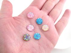 These multicolor flat backed rhinestone cabochons are awesome for all your crafting projects such as jewelry, cell phone deco, nails etc... You will get a mix of the colors I have in stock. Please note these have more sparkle in person, the photos do not do them justice! You can pick the amount you want to purchase in the drop down menu!  Size: 10mm Color: Multicolor Quantity: Pick either 50 or 100 pieces Material: Resin