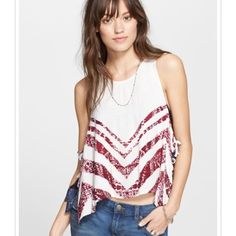 NWT Free People Sleeveless Printed Trapeze Tank Brand new with tags. Lightweight, borderline see-through tank. As shown in the second picture, the sides of the shirt are tied in two bows to keep it closed. 60% viscose 40% rayon Free People Tops Tank Tops