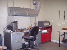 Inside my studio.  My lampworking work table, kiln and ventilation fan.