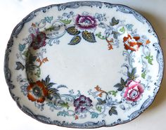 (William Brownfield) Savona Enameled and Clobbered / Hand Painted Flow Navy Blue Large Platter The dark, navy flow blue transfer combines plumes of scrolling vines and leaves and l Antique China, Vintage China, Blue And White, Navy Blue, Dark Navy, Yellow Turquoise, China Platter, Cute Kitchen, Vintage Dishes