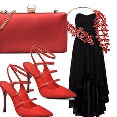 Per un evento importante è perfetto il vestito senza spalline nero, impreziosito da una collana che è una cascata di fiori rossi. Rossi sono anche gli accessori, le scarpe altissime con il cinturino alla caviglia e la piccola borsa.