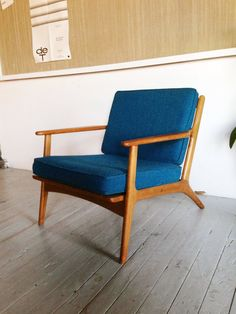 A beautiful mid-century Danish arm chair that is in excellent condition - it is upholstered in a teal, textured fabric, and the wood is a natural blonde color (I think maple?). The chair is unmarke...