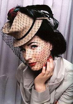 There is something about Dita Von Teese that is so... undescribable. Also love the hat.
